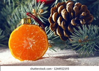 Christmas tree decorated with fruits of kiwi fruit and clementine. Healthy food and nutrition. Christmas decisions about a healthy lifestyle. New trends and prospects in a healthy lifestyle