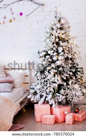 christmas tree decorated with large wooden snowflakes with gift boxes near the bed - Large Wooden Christmas Decorations