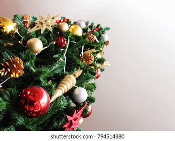 Christmas tree was decorated with red ball and gold shining star.