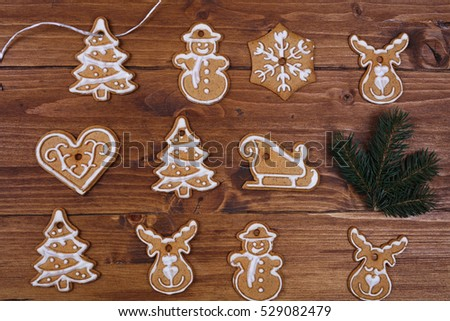 christmas tree decoration made from gingerbread cookies on wooden table new year background - Gingerbread Christmas Tree Decorations
