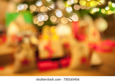 Christmas tree, decoration and many gifts on blur background