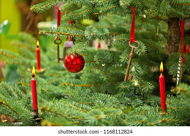 Christmas Tree with Decoration and Old Rusty Key