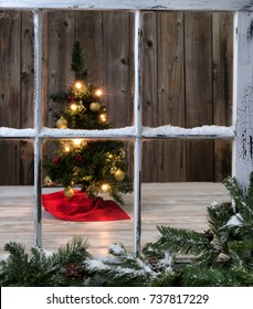 Christmas Tree decoration on wooden background with outdoor window in forefront