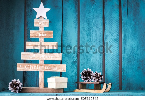 Christmas tree decoration on wooden blue background. DIY.