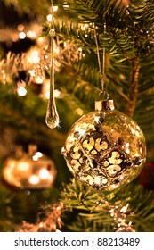 Christmas tree decoration in silver and glass with lights - vertical