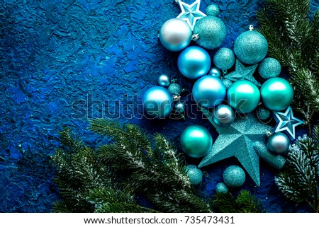 christmas tree decorations with balls and stars toys on blue background top view space for text
