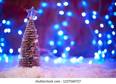 Christmas tree with decorations and gift boxes. Holiday background. Merry Christmas and Happy New Year.