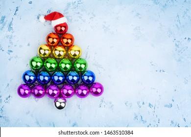 Christmas tree decorations glass balls LGBTQ community rainbow flag colors, Santa Claus hat, LGBT pride symbol, New Year holiday greeting card design, lesbian and gay xmas night party sign, copy space