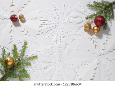 Christmas tree decorations on the background of a paper snowflake. Background for Christmas and New Year celebrations.