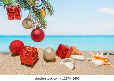 Christmas tree decorations on the beach in tropical sea. Concept of new year holiday in hot countries