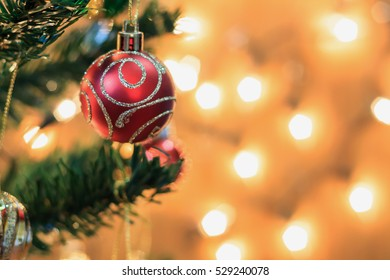 Christmas tree decorations on the branches background