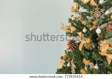 christmas tree with decorations on pastel color background