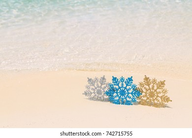 Christmas tree decorations on sea beach sand - winter holidays in tropics, Xmas festive concept
