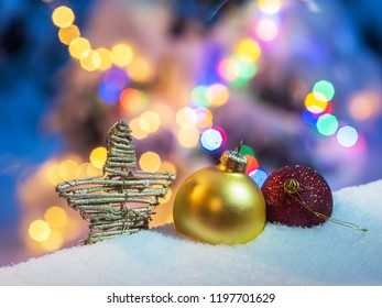 Christmas tree decorations in the snow. The symbol of Christmas and New Year.