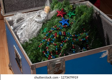 Christmas tree decorations taken down and packed away in storage. End or start of the Xmas holiday. Packing and unpacking the fake Christmas tree, fairy and baubles.
