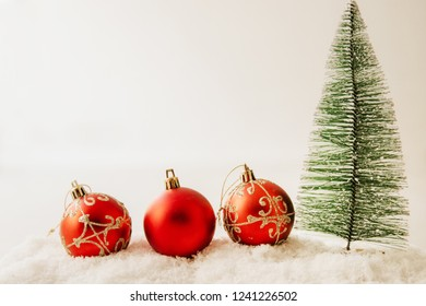 christmas tree and decorative balls with snow, christmas background