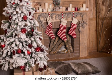 Of Christmas tree and fireplace with socks