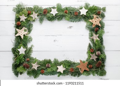 Christmas tree frame with wooden stars on wooden table