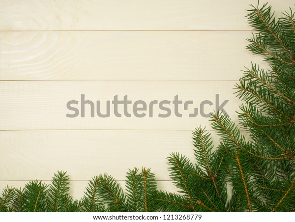 Christmas Tree Framework Branches On Wooden Stock Photo