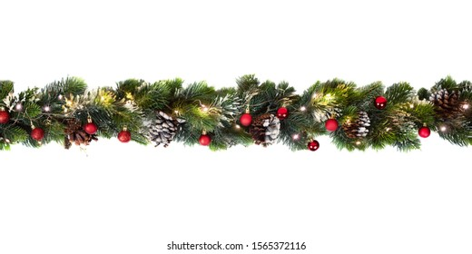 Christmas tree garland decorated with red baubbles and yellow lights, isolated on white, festive background banner