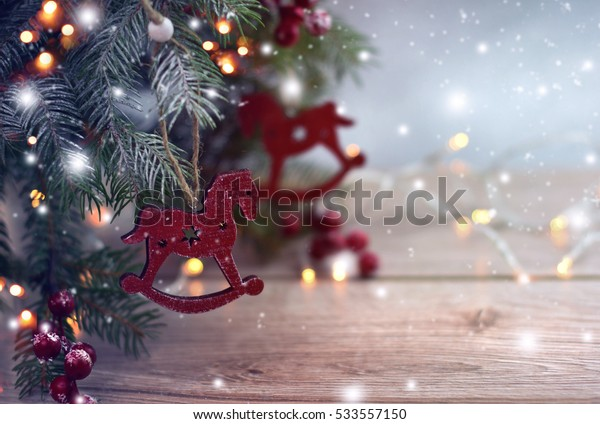Christmas tree with gift box and decorations on wooden background