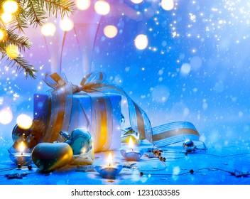 Christmas tree, Christmas gift box and holidays ornament; Christmas invitation card background