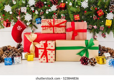 Christmas tree and gift boxes on white wooden background. Copy space