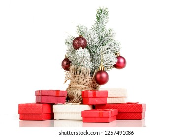 Christmas tree gift boxes with toys on a white background close up