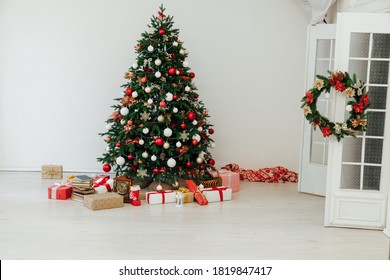 Christmas tree with gifts of garland lights for the new year in the interior of the room as a white background