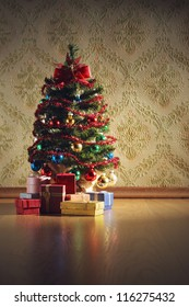 Christmas tree with gifts on decorative wallpaper