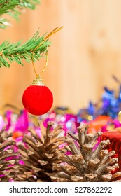 Christmas tree with gifts on wooden background.