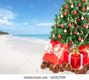 Christmas tree and gifts over beach background