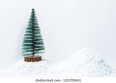 Christmas tree with gifts in snow drift. Free space for your text