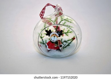 Christmas tree glass ball with Rudolf toy inside isolated on white background