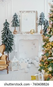 Christmas tree with golden decorations, vintage sofa at white room