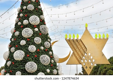 Christmas tree, Hanukkah menorah and crescent in Haifa, Israel