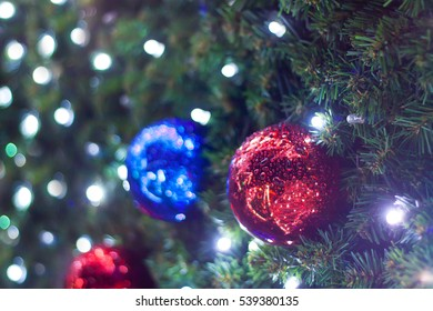 Christmas tree and holiday decorations in the central square of the city during the Christmas Fair. Blurred images and beautiful bokeh.