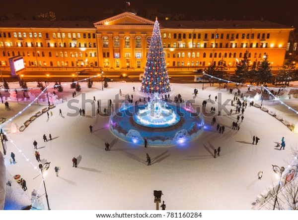 Christmas tree and holiday illumination. Tomsk winter cityscape, Novosobornaya square and Lenin avenue from aerial view. New Year eve