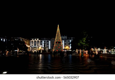 Christmas tree and holiday season decorations in city square of urban Lisbon Portugal