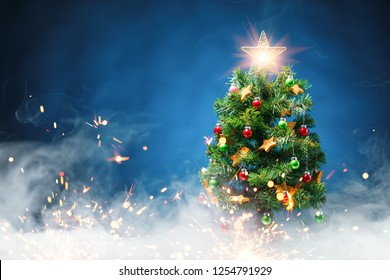 Christmas tree in ice fog, blue background