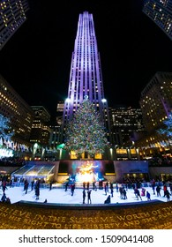 Christmas tree and ice skating rink in front of the 30 Rockefeller Plaza which is an American Art Deco skyscraper that forms centerpiece of Rockefeller Center. Manhattan, New York December 14, 2016