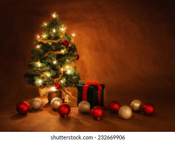 christmas tree illuminated with holiday decor with a glamour glow overlay effect