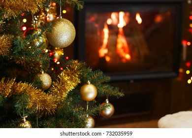 Christmas tree in interior with fireplace