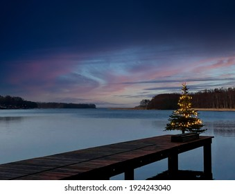 christmas tree at a lake in the evening