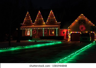 Christmas Tree light holiday decoration: illuminated windows, house and christmas trees in night. Bowmanville, Ontario, Canada