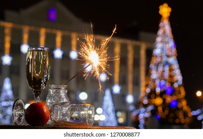 Christmas tree light night blur bokeh holiday abstract background Sparkler in the foreground