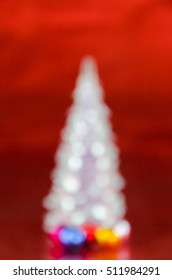 christmas tree lights on red background. Blurred