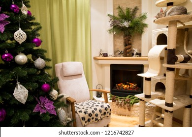 Christmas tree and Christmas living room with cat ocicat and fireplace and a lot of Christmas decoration. Christmas celebrating mood.