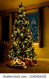 Christmas tree in living room with lights and decorations