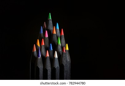 Christmas tree made of black wooden pencils